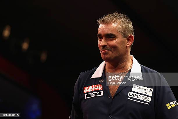 Steve Beaton of Great Britain reacts to winning his first round match against Magnus Caris of Sweden during day three of the 2012 Ladbrokescom World...