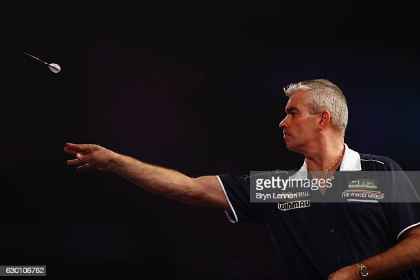 Steve Beaton of Great Britain throws against Devon Petersen of South Africa during day two of the 2017 William Hill PDC World Darts Championships at...