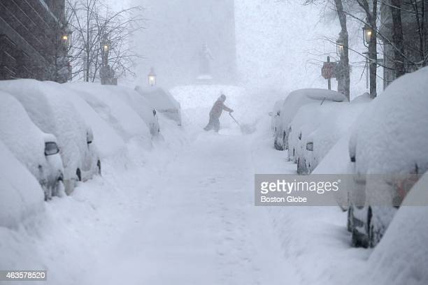 Steve Belge snowblows on Monument Ave People battle wind and snow during a Sunday morning blizzard in Charlestown