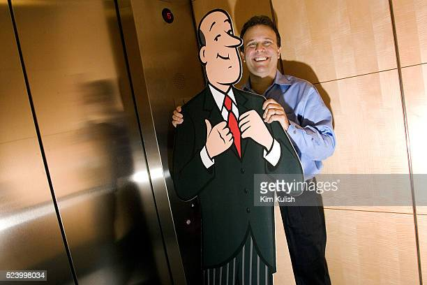 CEO Steve Berkowitz laughs as he rides the elevator up with his trademark butler icon as Ask Jeeves moves into their new corporate headquarters in...