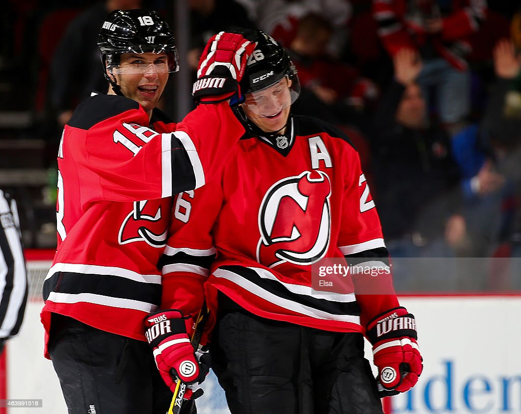 Steve Bernier #18 and Patrik Elias #26 of the New Jersey Devils celebrate the win over the Vancouver Canucks on February 20, 2015 at the Prudential Center in Newark, New Jersey.The New Jersey Devils defeated the Vancouver Canucks 4-2.