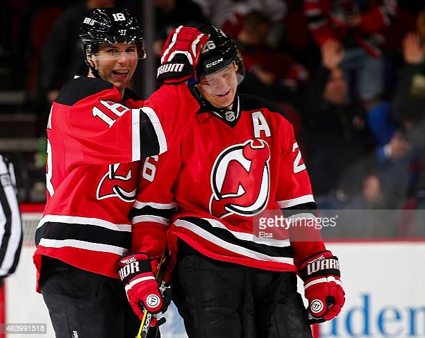 Steve Bernier and Patrik Elias of the New Jersey Devils celebrate the win over the Vancouver Canucks on February 20 2015 at the Prudential Center in...
