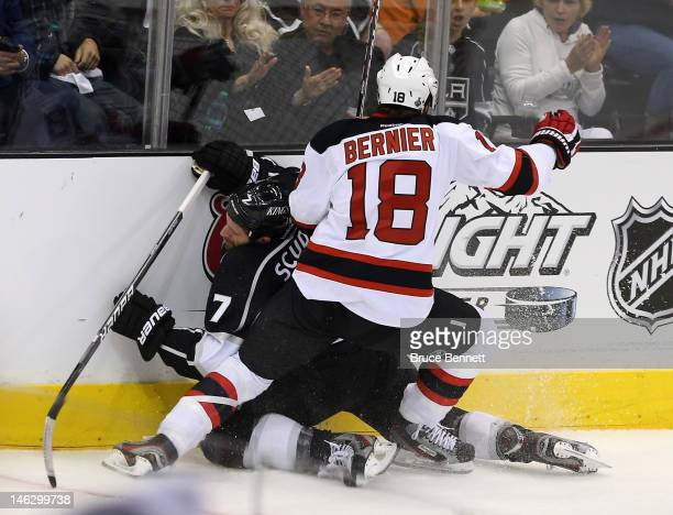 Steve Bernier of the New Jersey Devils boards Rob Scuderi of the Los Angeles Kings in the first period of Game Six of the 2012 Stanley Cup Final at...