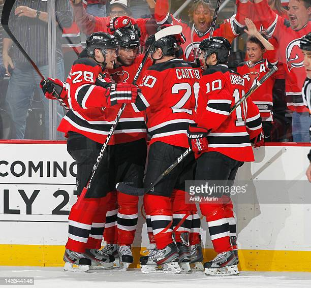 Steve Bernier of the New Jersey Devils is congratulated by his teammates after scoring a first-period goal against the Florida Panthers in Game Six...