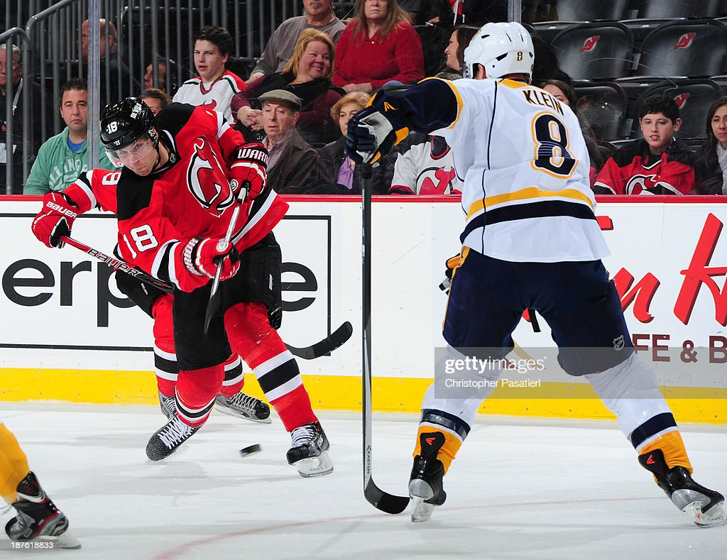 Steve Bernier #18 of the New Jersey Devils takes a shot on goal against Kevin Klein #8 of the Nashville Predators during the second period on November 10, 2013 at the Prudential Center in Newark, New Jersey.