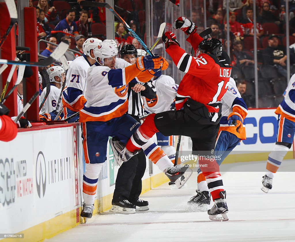 Steve Bernier #8 of the New York Islanders and Ben Lovejoy #12 of the New Jersey Devils colide during the third period at the Prudential Center on October 5, 2016 in Newark, New Jersey. The Islanders defeated the Devils 3-2.