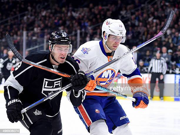 Steve Bernier of the New York Islanders and Brayden McNabb of the Los Angeles Kings get tangled as they chase after a puck to the boards during the...