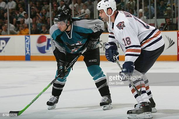 Steve Bernier of the San Jose Sharks readies for a faceoff with Ethan Moreau during Game 2 of the Western Conference Semifinals against the Edmonton...