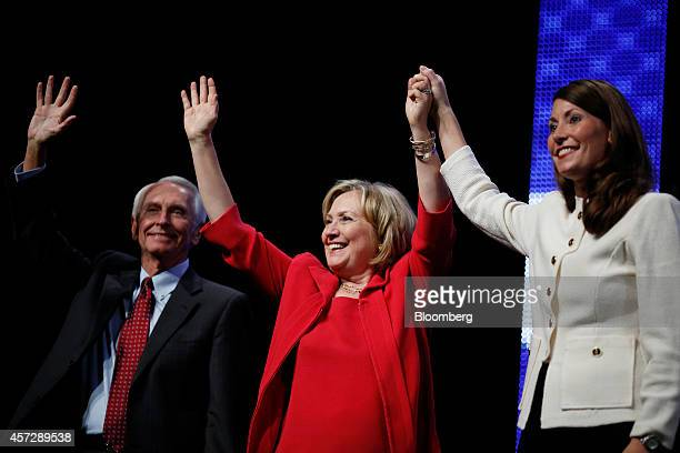 Steve Beshear governor of Kentucky left Hillary Clinton former US secretary of state center and Alison Lundergan Grimes the Democratic candidate for...
