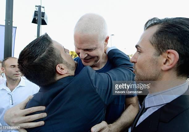 Steve Bing film producer businessman and donor to progressive causes congratualtes plaintiff Paul Katami and plaintiff Jeff Zarillo as they celebrate...