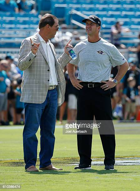Steve Bisciotti owner of the Baltimore Ravens talks to head coach John Harbaugh prior to the NFL game against the Jacksonville Jaguars on September...