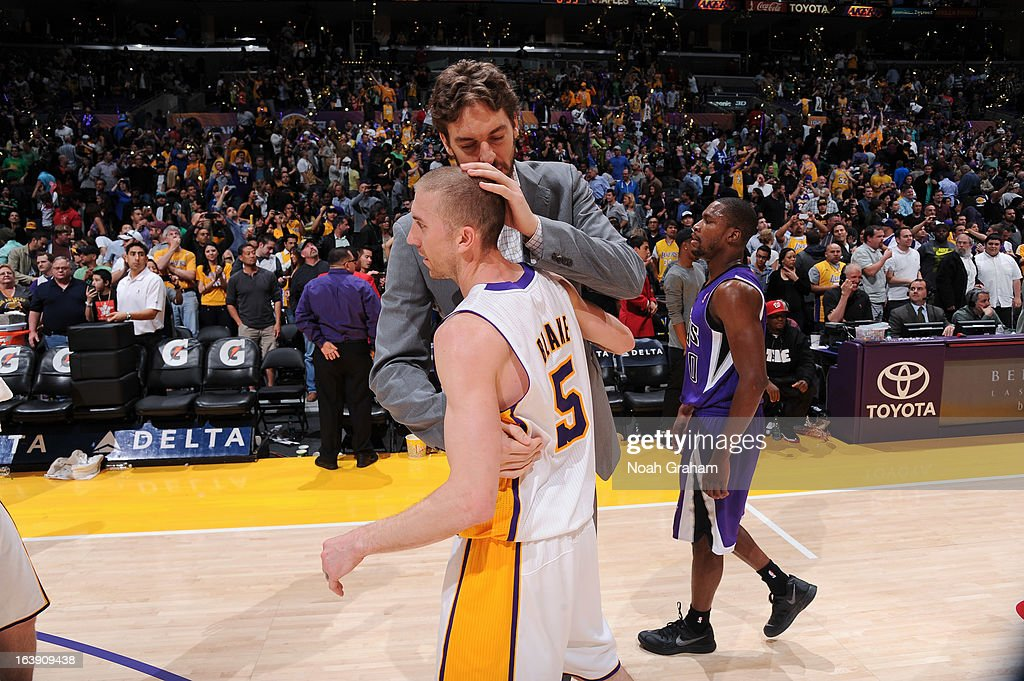 Steve Blake #5 and Pau Gasol #16 of the Los Angeles Lakers celebrate following their team's victory against the Sacramento Kings at Staples Center on March 17, 2013 in Los Angeles, California.