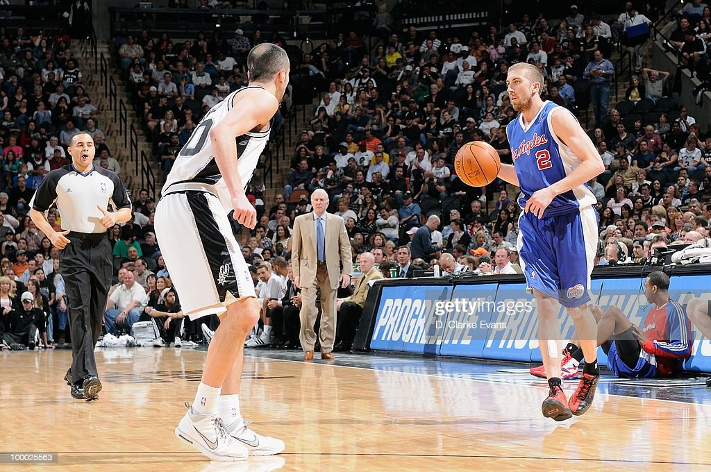 Steve Blake #2 of the Los Angeles Clippers moves the ball against Manu Ginobili #20 of the San Antonio Spurs during the game on March 13, 2010 at the AT&T Center in San Antonio, Texas. The Spurs won 118-88.