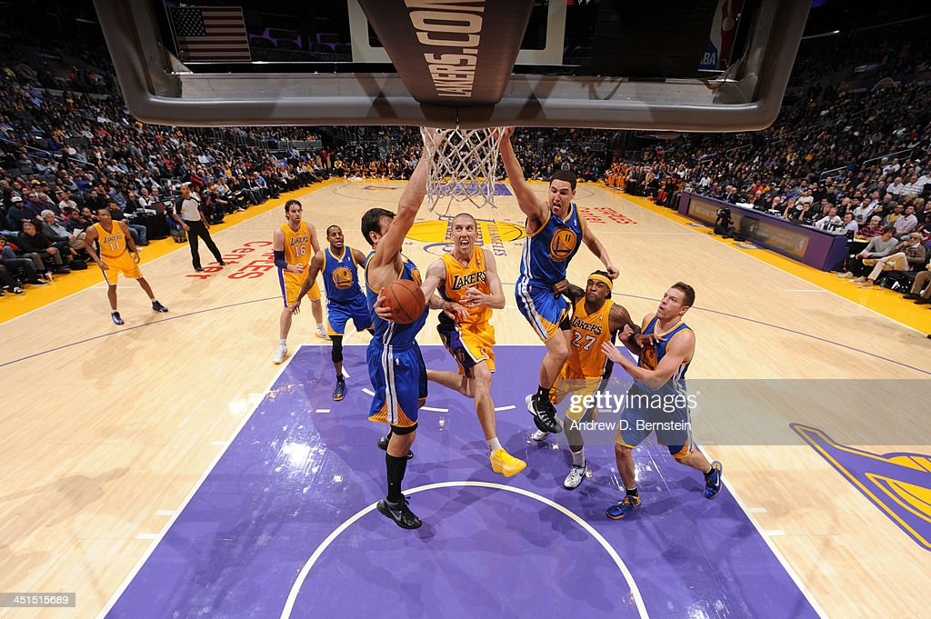 Steve Blake #5 of the Los Angeles Lakers attempts a shot during a game against the Golden State Warriors on November 22, 2013 at STAPLES Center in Los Angeles, California.