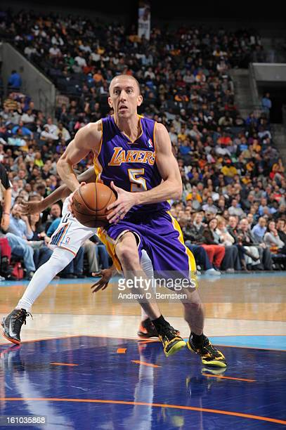 Steve Blake of the Los Angeles Lakers drives to the basket against the Charlotte Bobcats on February 8 2013 at the Time Warner Cable Arena in...