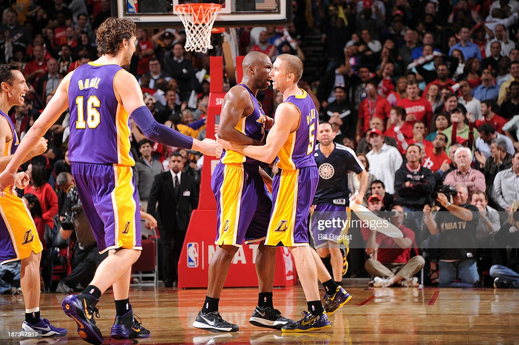 Steve Blake #5 of the Los Angeles Lakers hugs his teammates after hitting a game winning three pointer against the Houston Rockets on November 7, 2013 at the Toyota Center in Houston, Texas.