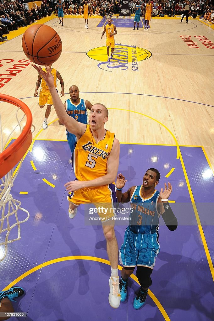 Steve Blake #5 of the Los Angeles Lakers puts up a shot against Chris Paul #3 of the New Orleans Hornets at Staples Center on January 7, 2011 in Los Angeles, California.