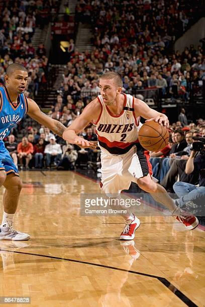 Steve Blake of the Portland Trail Blazers drives against Earl Watson of the Oklahoma City Thunder during the game on April 13 2009 at the Rose Garden...