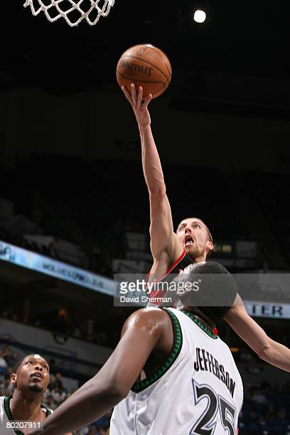 Steve Blake of the Portland Trail Blazers shoots against Al Jefferson of the Minnesota Timberwolves on March 11 2008 at the Target Center in...