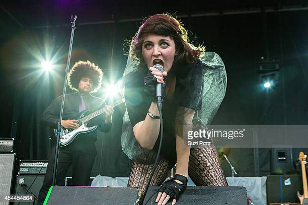 Steve Bonnell and Ryann Donnelly of Schoolyard Heroes performs at the Bumbershoot Music and Arts Festival on August 31 2014 in Seattle Washington