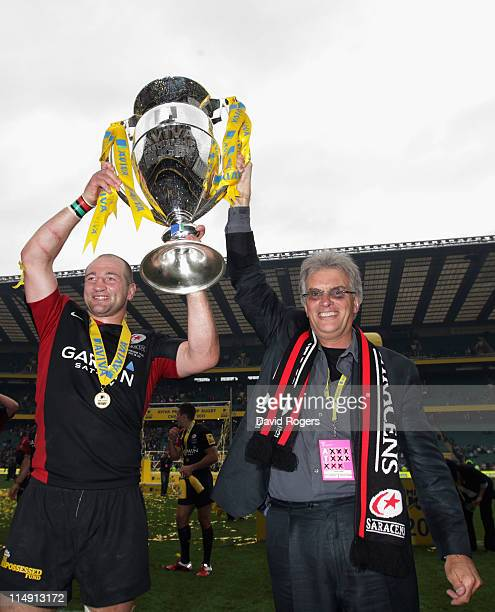 Steve Borthwick and Nigel Wray of Saracens celebrate with the Aviva Premiership trophy during the AVIVA Premiership Final between Leicester Tigers...
