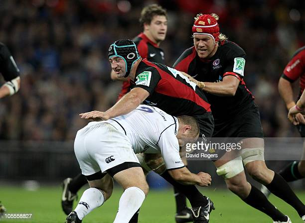 Steve Borthwick of Saracens is tackled by Richardt Strauss during the Heineken Cup match between Saracens and Leinster at Wembley Stadium on October...