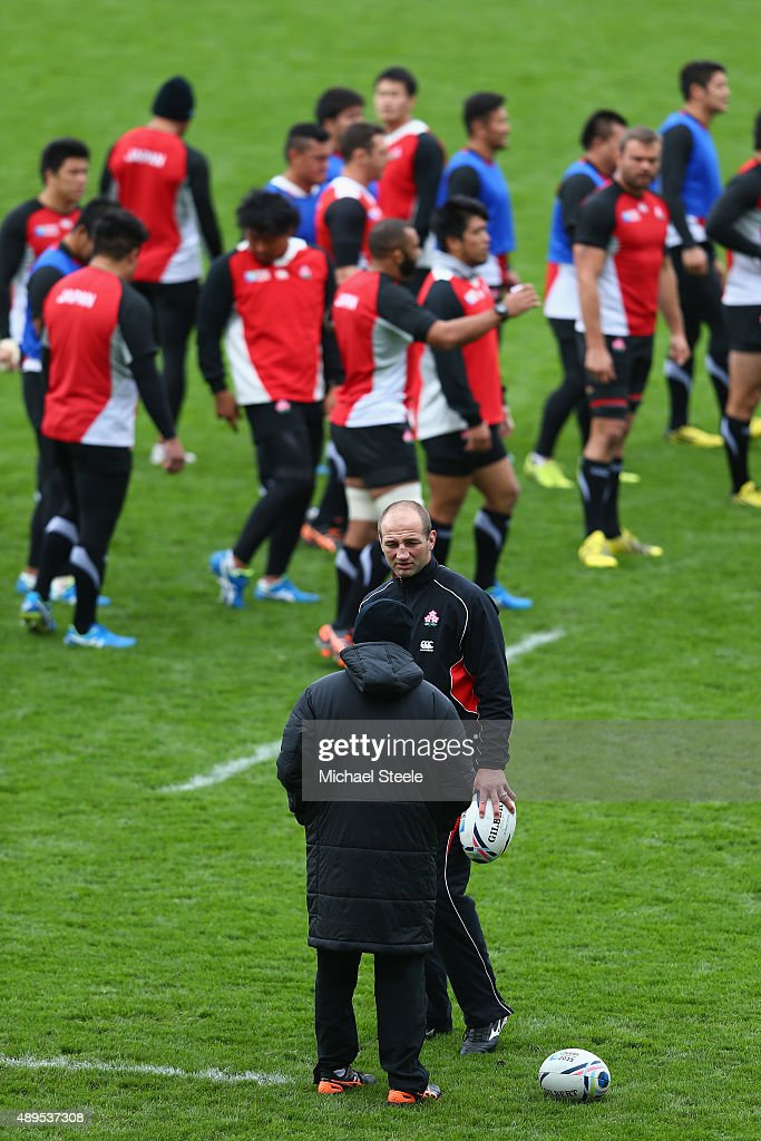 Steve Borthwick the Forwards Coach of Japan in conversation with Eddie Jones the Head Coach of Japan during the Captain's Run ahead of the Japan versus Scotland Pool B match at Kingsholm Stadium on September 22, 2015 in Gloucester, England.