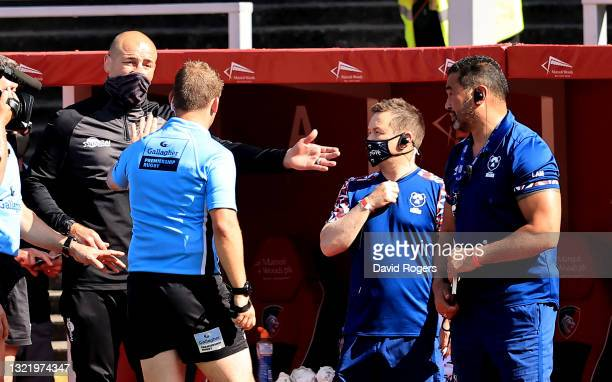 Steve Borthwick, the Leicester Tigers director of rugby, argues with referee Ian Tempest, as Pat Lam, the Bristol Bears director of rugby looks on...
