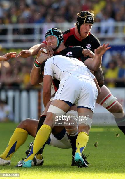 Steve Borthwick the Saracens captain is tackled by Alexandre Lapandry during the Heineken Cup match between ASM Clermont Auvergne and Saracens at...