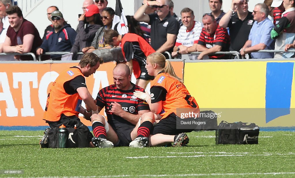 Steve Borthwick the Saracens captain receives attention to a shoulder injury during the Aviva Premiership semi final match between Saracens and Harlequins at Allianz Park on May 17, 2014 in Barnet, England.