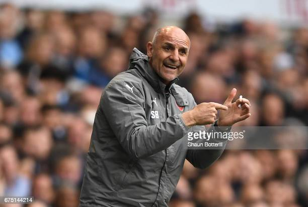 Steve Bould Arsenal assistant manager gives his team instructions during the Premier League match between Tottenham Hotspur and Arsenal at White Hart...