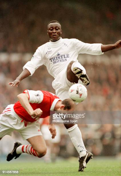Steve Bould of Arsenal dives in to stop Tony Yeboah of Leeds United during an FA Carling Premiership match at Elland Road on October 14 1995 in Leeds...