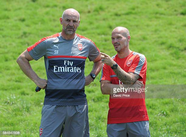 Steve Bould the Arsenal Assistant Manager chats to Freddie Ljungberg ex Arsenal player during the Arsenal Training Session at The Stubhub Centre on...