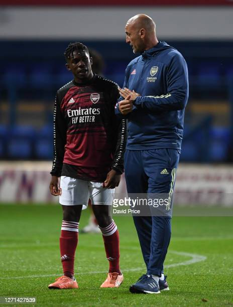Steve Bould the Arsenal U23 Manager chats to Tim Akinola of Arsenal before the Leasingcom Cup match between Ipswich Town and Arsenal U21 at Portman...
