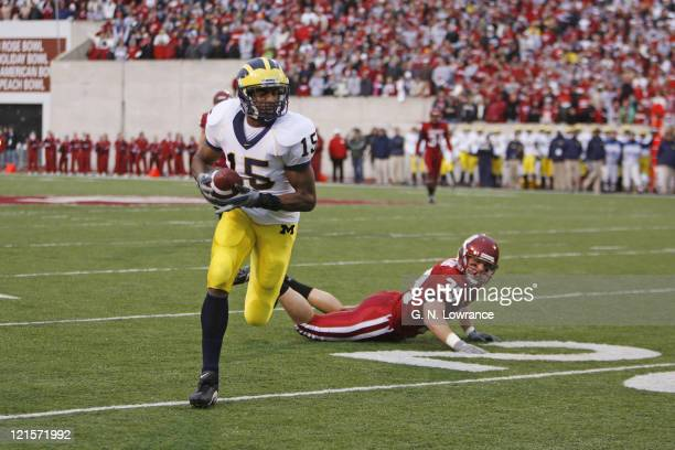 Steve Breastan of Michigan runs with a 62 yard touchdown reception in the 2nd quarter against the Indiana Hoosiers at Memorial Stadium in Bloomington...