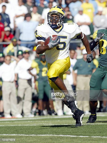 Steve Breaston of the Michigan Wolverines makes a touchdown catch against the Oregon Ducks at Autzen Stadium in Eugene Oregon Oregon defeated...