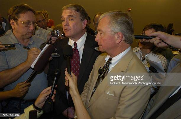 Steve Brittain center and Dick DeGuerin left attorneys for Rep Tom Delay speak at a news conference at the Travis County Court House on Wednesday...