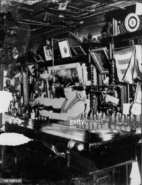 Steve Brodie serves drinks at his establishment Steve Brodie's Saloon at 114 Bowery New York City circa 1890 Steve Brodie gained publicity for...