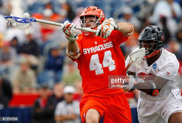 Steve Brooks of the Syracuse Orange loses control of the ball to Shamel Bratton of Virginia Cavaliers during NCAA Lacrosse Semifinals at Gillette...