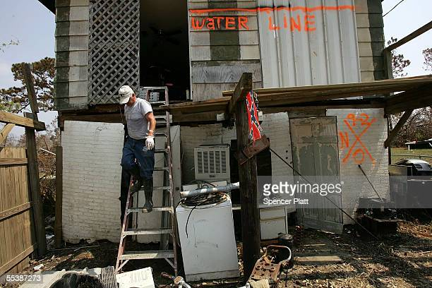 Steve Brosh walks down a ladder from the top floor of his destroyed home September 12 2005 in Biloxi Mississippi Thousands of residents of the Gulf...