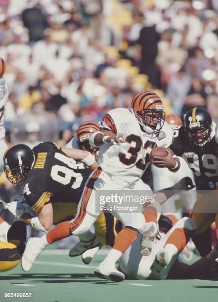 Steve Broussard Running Back for the Cincinnati Bengals runs the ball through the Steelers during the American Football Conference Central game...