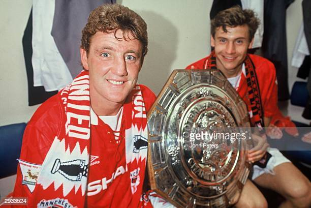 Steve Bruce and Andrei Kanchelskis celebrate in the dressing room after the Arsenal v Manchester United Charity Shield match at Wembley Stadium...