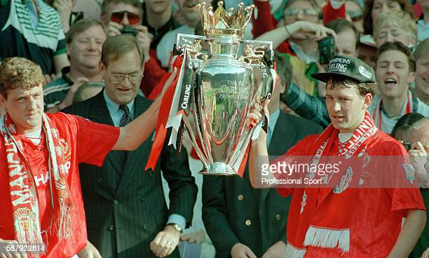 Steve Bruce and Bryan Robson of Manchester United holding the Premier League Championship trophy after their final home game of the season against...