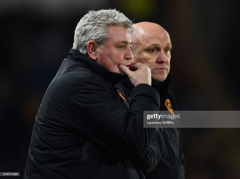 Steve Bruce and Mike Phelan of Hull City looks on during the Sky Bet Championship match between Hull City and Brighton and Hove Albion at KC Stadium on February 16, 2016 in Hull, United Kingdom.
