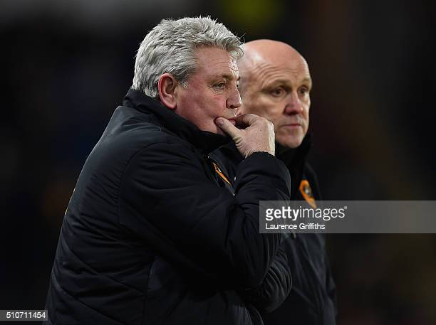 Steve Bruce and Mike Phelan of Hull City looks on during the Sky Bet Championship match between Hull City and Brighton and Hove Albion at KC Stadium...