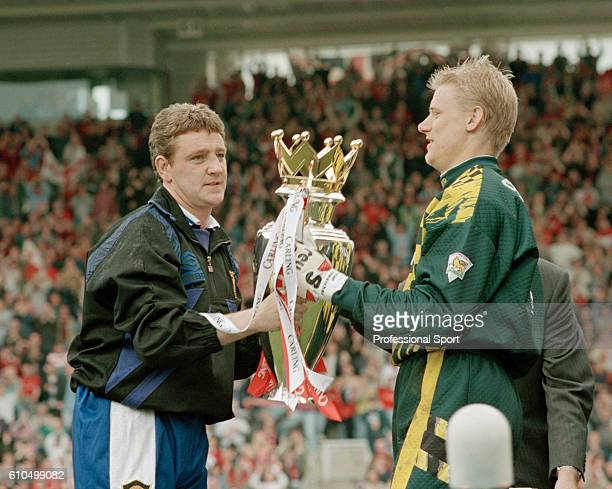 Steve Bruce and Peter Schmeichel of Manchester United holding the premiership trophy after winning the 1995/96 title after the FA Carling Premiership...