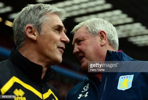 Steve Bruce, Manager of Aston Villa chats with Alan Irvine, Caretaker Manager of Norwich City during the Sky Bet Championship match between Aston...