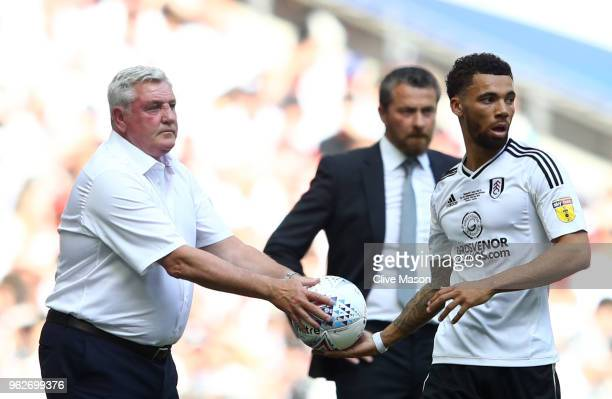Steve Bruce Manager of Aston Villa gives the ball to Ryan Fredericks of Fulham during the Sky Bet Championship Play Off Final between Aston Villa and...