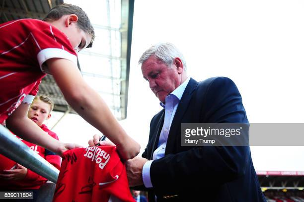 Steve Bruce Manager of Aston Villa signs an autograph during the Sky Bet Championship match between Bristol City and Aston Villa at Ashton Gate on...