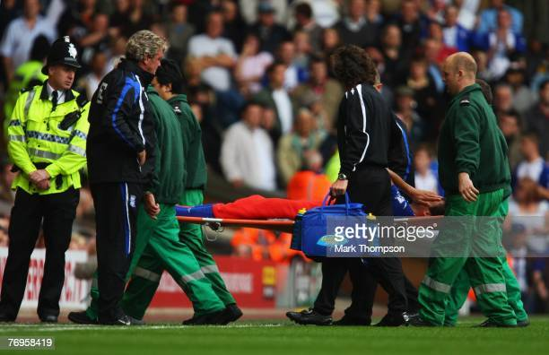 Steve Bruce manager of Birmingham City looks on as Borja Oubina is stretchered off to the Barclays Premier League match between Liverpool and...